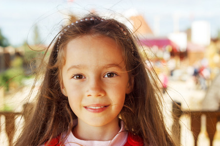 little colours: Pretty little girl smiling in a park close up