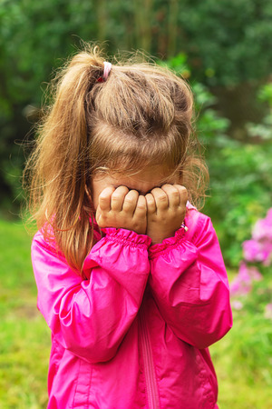 argue kid: Unhappy Child is crying outdoors