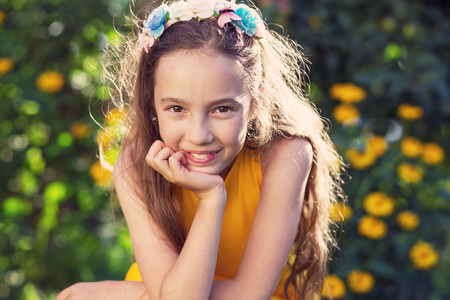 Beauty Happy  Girl Outdoors enjoying nature. Beautiful Teenage girl with long hair smiling at sunny day. Toned in warm colors