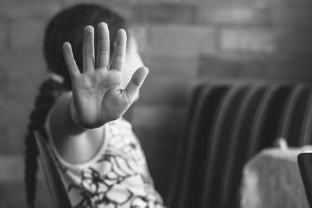 Little girl shows stop. Children violence and abused concept. Stock Photo