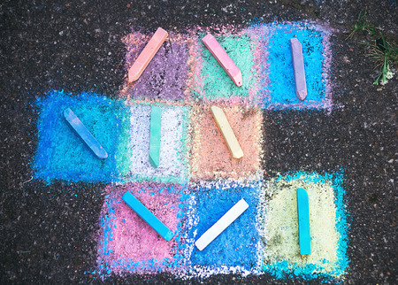 Colored chalk on a sidewalk  background, top view Stock Photo