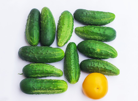 Group of cucumbers and a tomato with different colors, different and unique concept