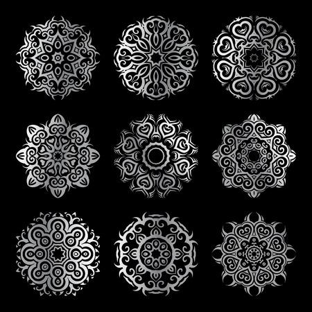 background kaleidoscope: Silver mandala on black background. Ethnic vintage pattern collection.