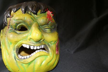 hellion: Monster head on black backround. Stock Photo