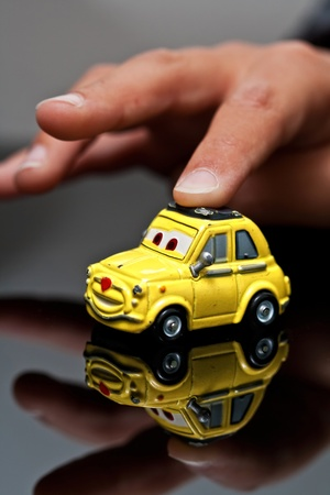a reflection with small hands and small car Stock Photo - 11296886