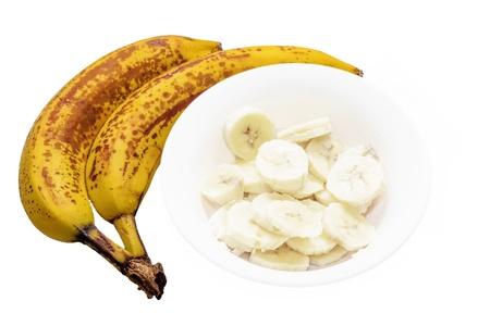 Bue banane con banane tagliate su sfondo bianco Archivio Fotografico