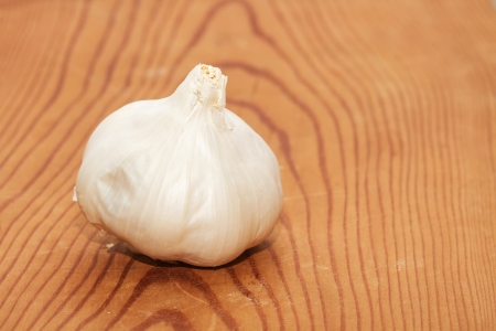 Garlic on wooden board Stock Photo - 18518365