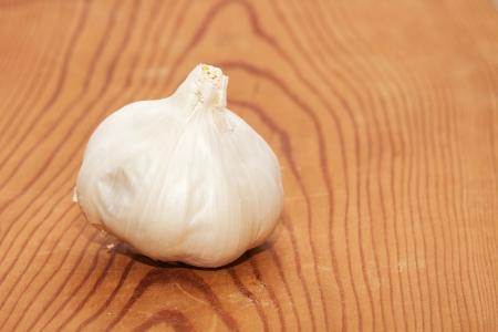 Garlic on wooden board Stock Photo - 18518365