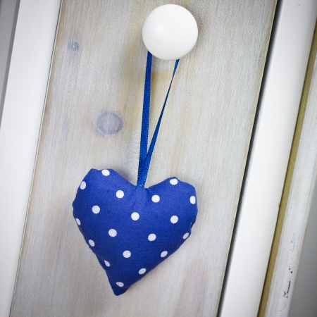 blue heart on wooden background