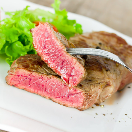 steak and salad photo