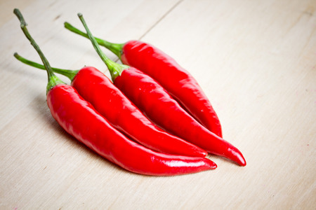 chili peppers on wooden background photo