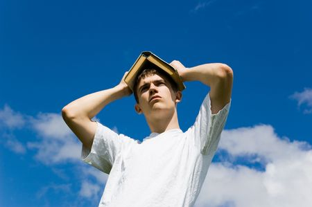 Young man on a background blue sky. photo