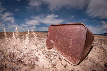 Rusty Trash In Desert Stock Photo