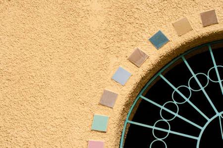 stucco: Stucco Wall with Tiles Stock Photo