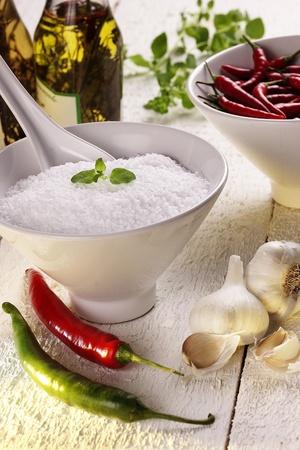 Still life spices:  salt, garlic, peperoni, chillies, chili, oregano