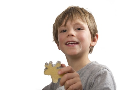 Boy showing his cookie, an elk, made for christmas Stock Photo - 11476847
