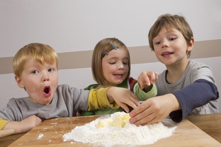 Kids having fun making dough photo
