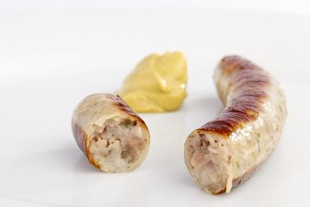 bratwurst: Bavarian sausage with mustard on a white background