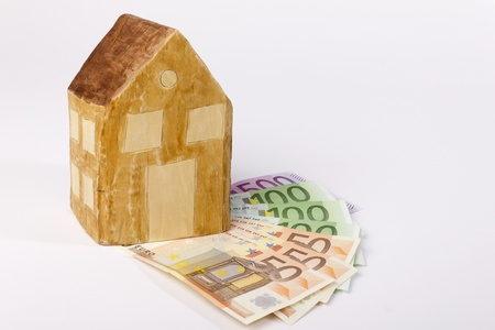 modell: Modell house made out of wood on banknotes