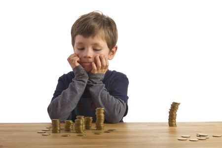 Boy building towers out of money photo
