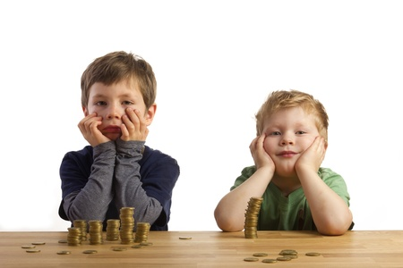 counting money: Boys sitting in front of towers built of money