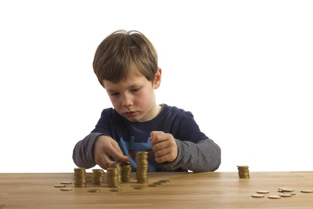 cent: Boy building towers with 50 Euro Cent coins Stock Photo