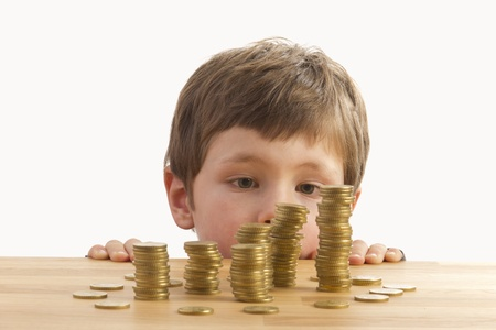 golden coins: Boys looking at towers of money