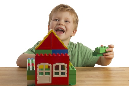 Boy is building a house photo