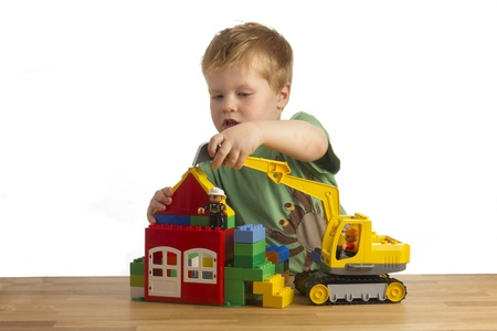 attentive: Boy is building a house