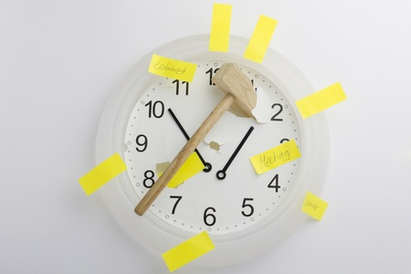 Clock with a hammer and memos photo