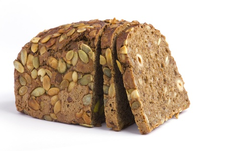 pumpkinseed: One loaf of rye bread on a white background Stock Photo