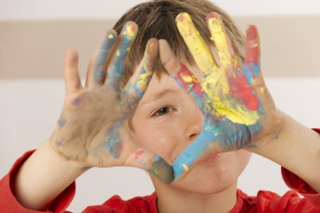 Boy shows his painted hands Stock Photo - 13555084