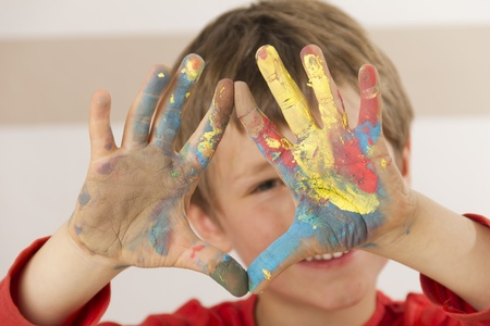 Boy shows his painted hands photo