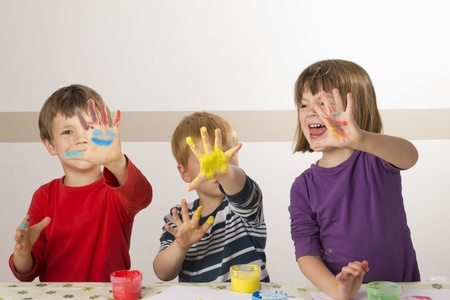 Children having fun painting with finger paint Stock Photo - 13555085