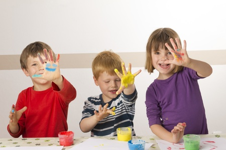 Children having fun painting with finger paint Stock Photo - 13555088