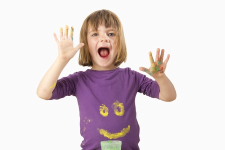 Girl painting with finger paint a face on her shirt Stock Photo - 13555071