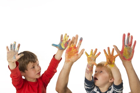 Father and his kids are showing their painted hands Stock Photo - 13555092