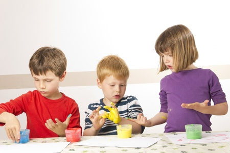 Children having fun painting with finger paint Stock Photo - 13555098