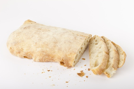 A sliced ​​ciabatta bread on white background photo