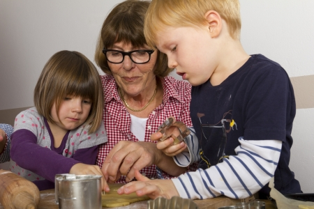 Grandma and her grandchildren cutting out cookies Stock Photo - 16192356