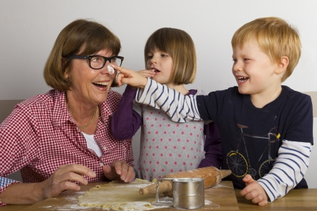 grandma bakes with her grandchildren