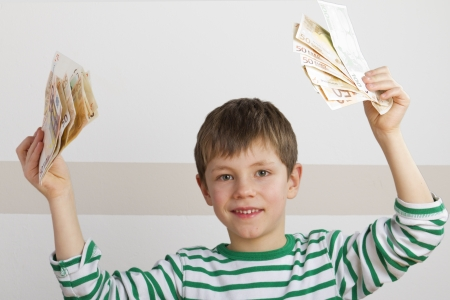 Happy boy with money in his hand Stock Photo