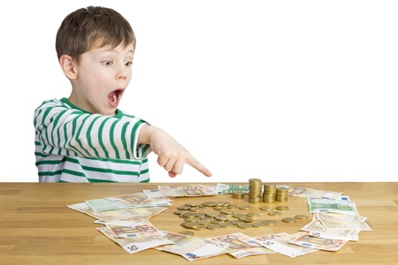 Boy points to a lot of money photo