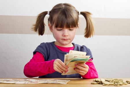 Girl is counting bank notes Standard-Bild