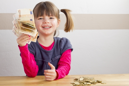 Happy girl with money in her hand photo