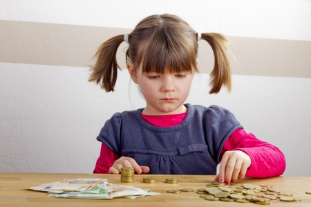 Happy girl is playing with money