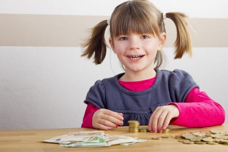 Happy girl is playing with money photo