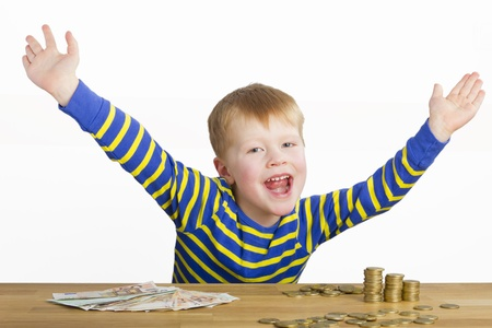 Happy boy in front of money Stock Photo