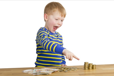 Young boy ponts to money towers photo