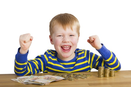 Happy boy in front of money Standard-Bild